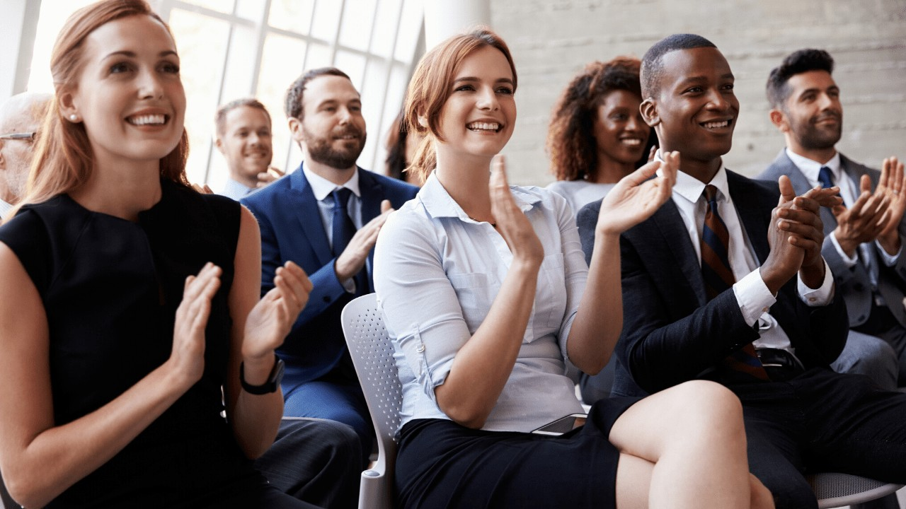 Business people clapping