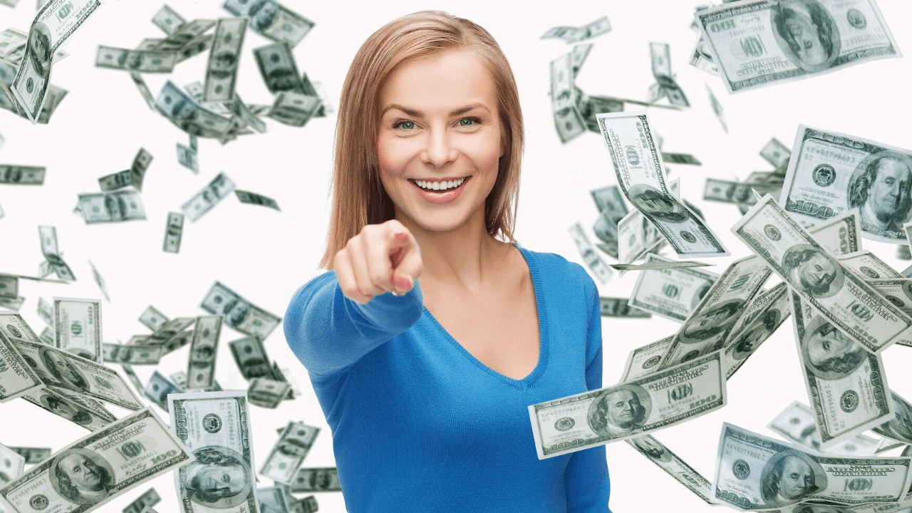 girl pointing money floating